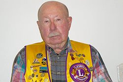 Richard Klinzing proudly wears his Lions Club vest