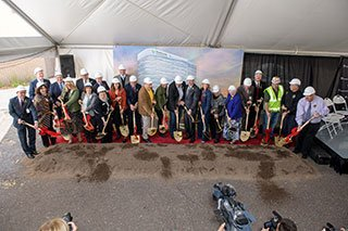 people with shovels at a groundbreaking