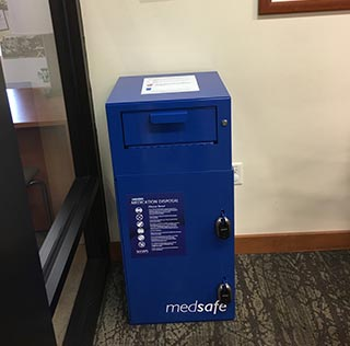 Blue drop box for safely discarding unwanted medications.