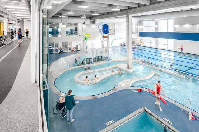 Hermantown Wellness Center pool area with lazy river and kids water play area